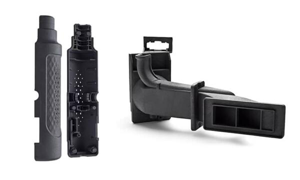 A collection of 3D printed parts produced using the HP MJF 5210 system, dyed black.