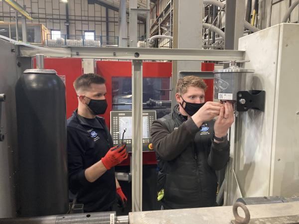Tris UK engineers changing oil cleaning filters at McAlpine