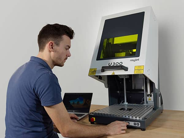 Man using the new U300 Laser Marker from Trotec Laser